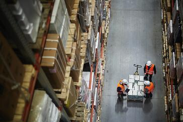 Overhead Of People In Warehouse